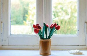 Red flowers in a brown vase